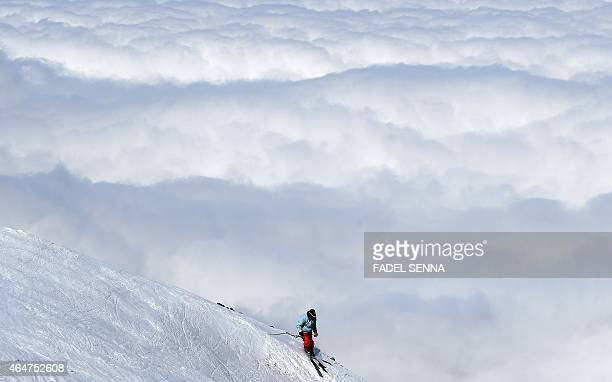 A skier descends a slope at the Oukaimeden ski resort in the Atlas Mountains 30 kilometres from the popular tourist resort of Marrakesh on February...