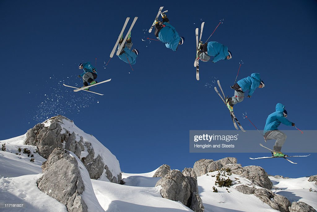 Skier doing dangerous free ride jump : Stock Photo