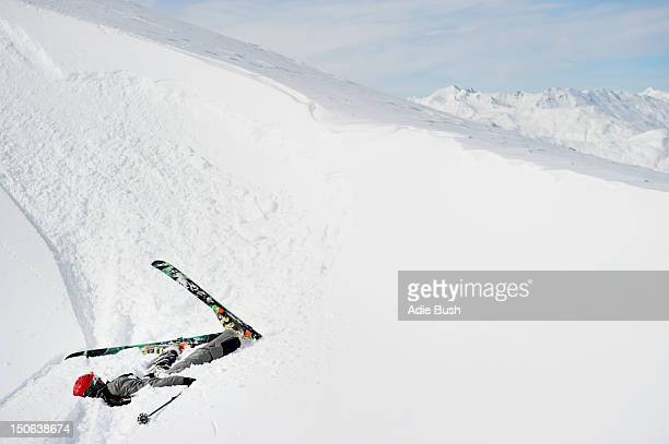 Skier doing flip on snowy slope