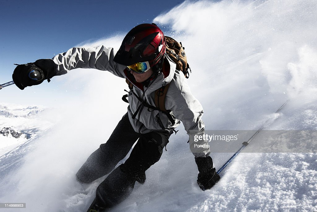 Skier downhill in deep snow : Stock Photo
