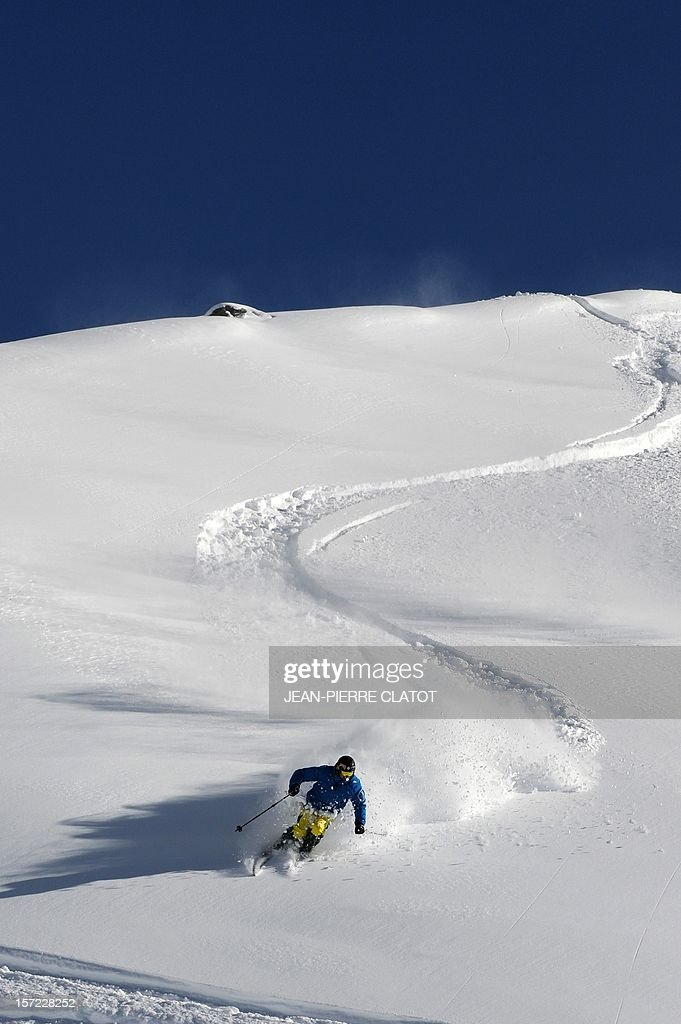 A skier enjoys a slope in Val Thorens, in the French Alps, on November 30, 2012. Recent snowfalls have encouraged skiers to hit the slopes and the Val Thorens authorities have opened certain slopes early ahead of the skiing station's full opening on December 8. AFP PHOTO / Jean Pierre Clatot