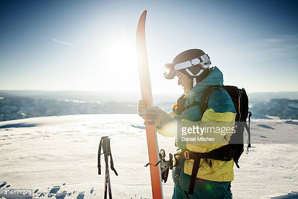 Skier getting ready to ski in the backcountry.
