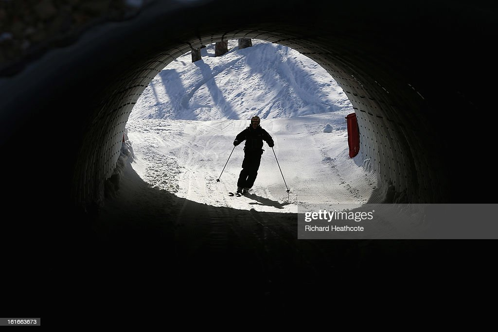 A skier goes through a tunnel to a different slope at the Rosa Khutor Alpine Ski Resort in Krasnaya Polyana on February 14, 2013 in Sochi, Russia. Sochi is preparing for the 2014 Winter Olympics with test events across the venues.