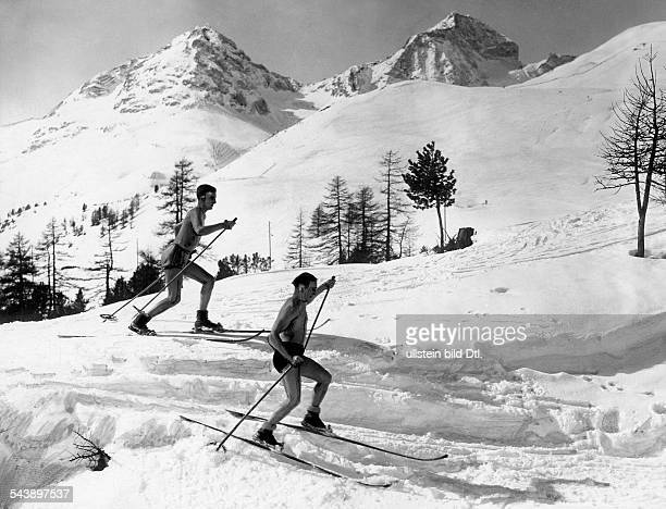 Skier in bathing trunks doing crosscountry skiing'Naturism on the Piz Julier in the Engadin' Photographer Gerhard Riebicke Published by 'BZ' Vintage...