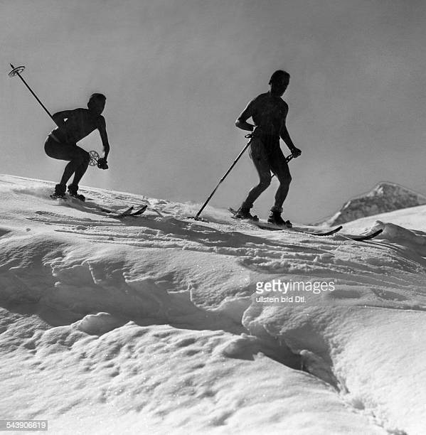 Skier in bathing trunks speeding down a piste'Naturism on the Piz Julier in the Engadin' Photographer Gerhard Riebicke Published by 'Der Querschnitt'...