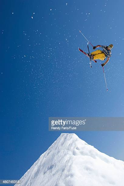 Skier Jumping High over Snow