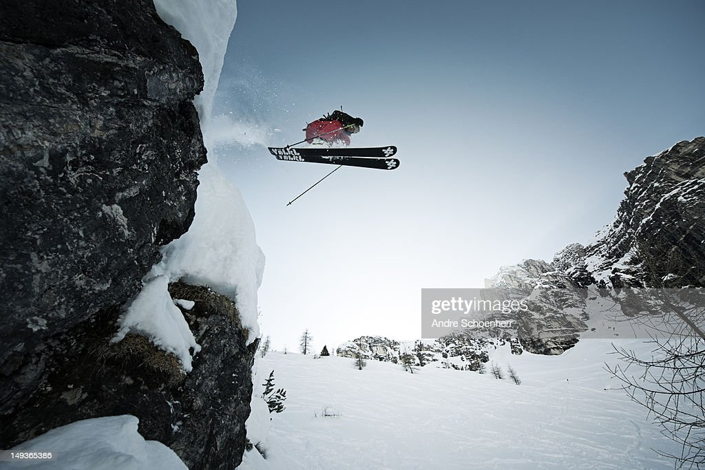 skier jumping of a cliff