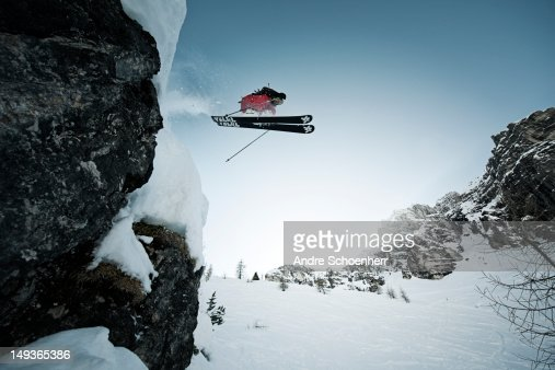 skier jumping of a cliff : Stock Photo