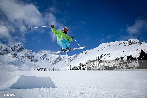 A skier jumping over a small mound