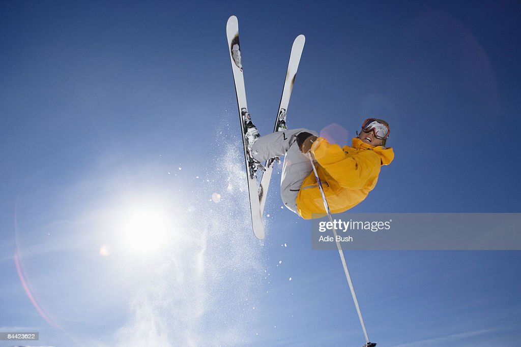 Skier jumping shot from bellow : Stock Photo