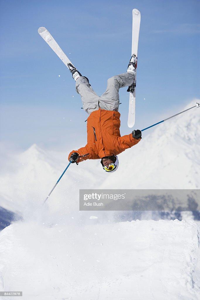 Skier jumping upside-down