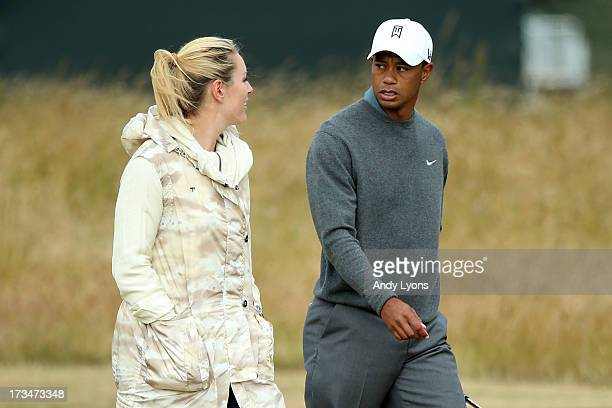Skier Lindsey Vonn and Tiger Woods of the United States walk the course ahead of the 142nd Open Championship at Muirfield on July 15 2013 in Gullane...