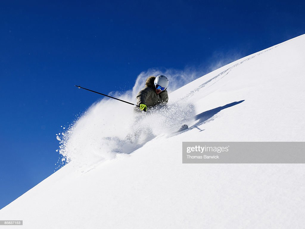 Skier making tracks in fresh powder : Stock Photo