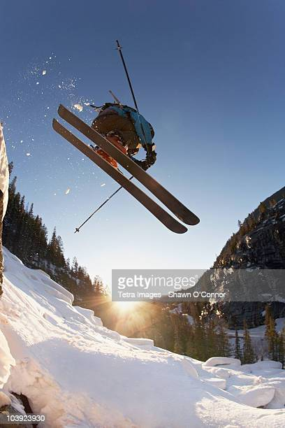 Skier mid jump in Aspen Colorado
