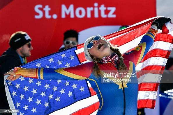 TOPSHOT US skier Mikaela Shiffrin holds a US flag as she celebrates winning the women's slalom race at the 2017 FIS Alpine World Ski Championships in...