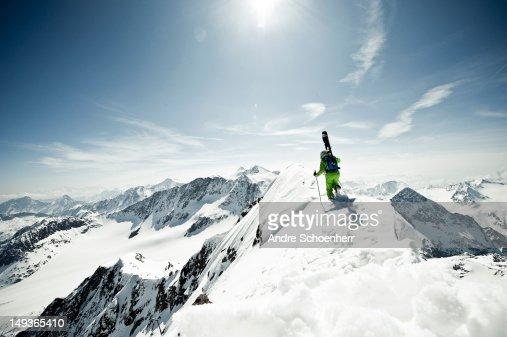 skier on a snowy ridge