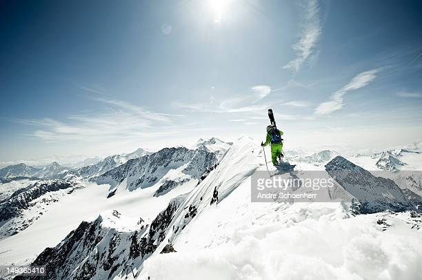 skier on a snowy ridge