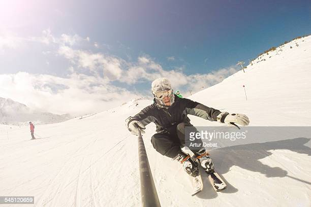 Skier on Pyrenees taking selfie with selfie stick