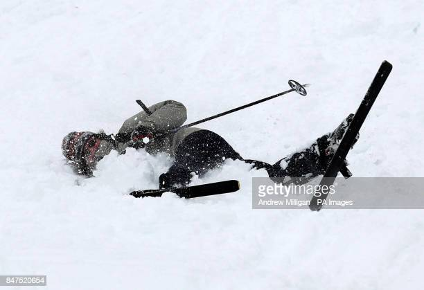 Skier Paul Cunningham from Perth takes a tumble at the Glenshee Ski resort in the Cairngorms