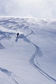 Skier riding down fresh powder, elevated view