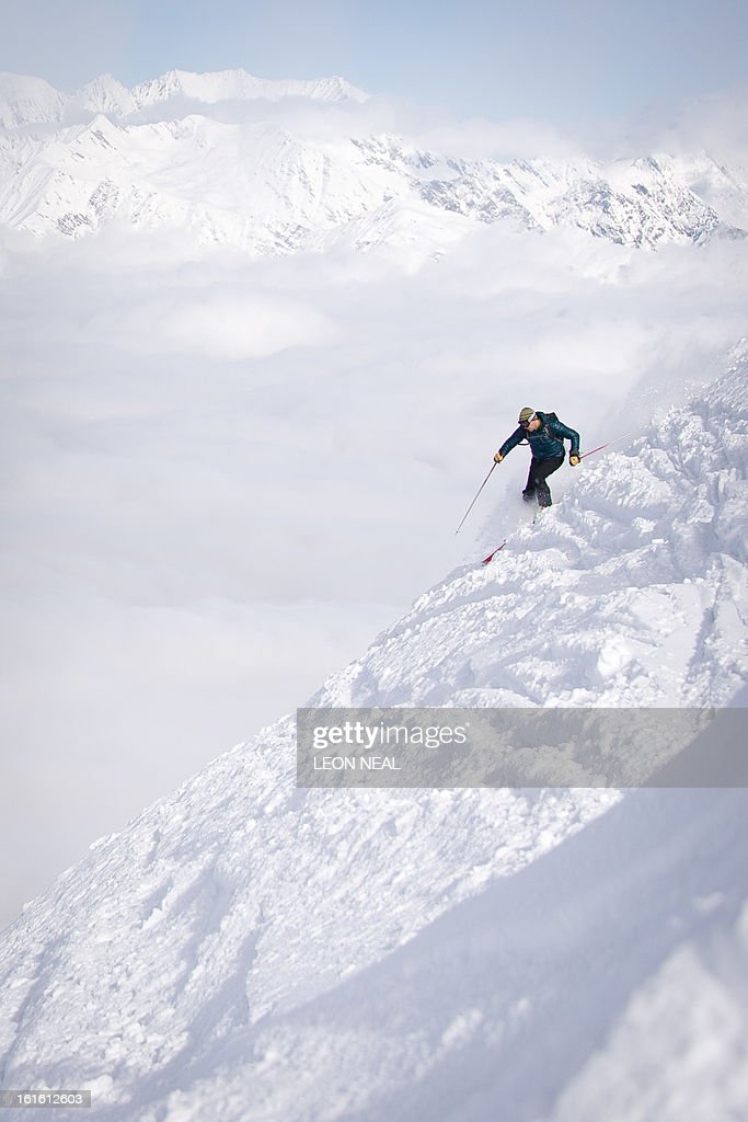 A skier sets off from the peak of Mount Aigba in the Rosa Khutor Extreme Park, some 50 km from Russia's Black Sea resort of Sochi, on February 13, 2013. With a year to go until the Sochi 2014 Winter Games, construction work continues as tests events and World Championship competitions are underway.