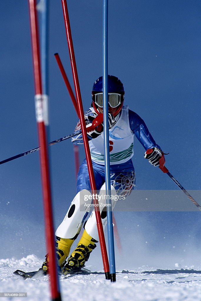 Skier skiing in between red and blue poles : Stock Photo