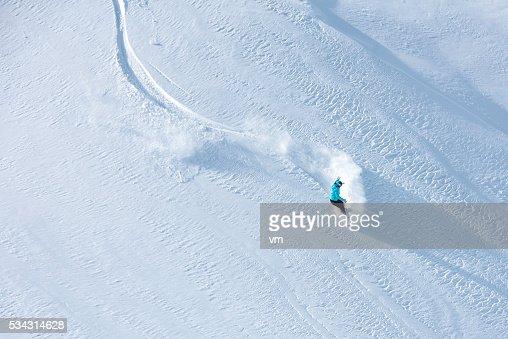 Skier skiing off-piste on a beatiful mountain slope