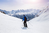 Skier skiing on red slope in Alps mountains near Chamonix, France