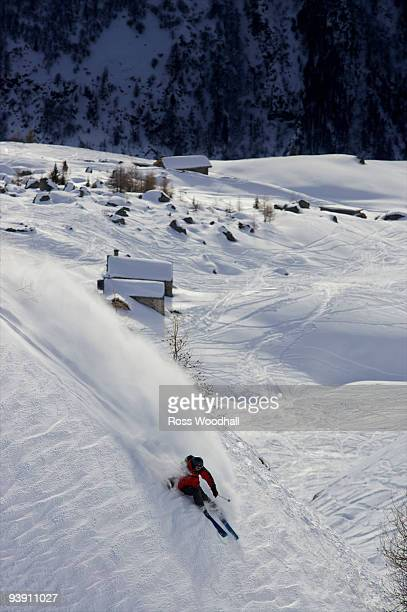 Skier turning down a slope.
