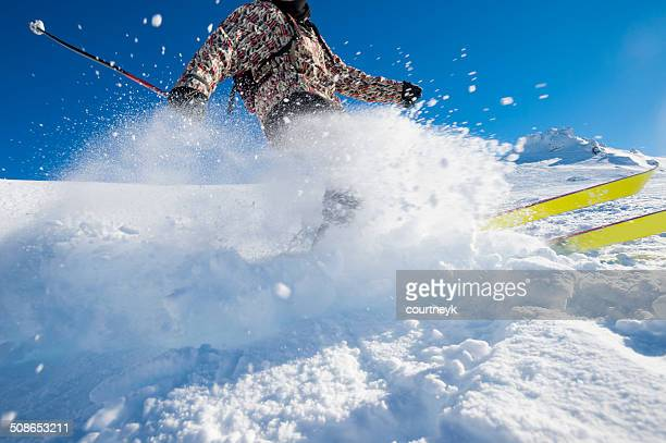 Skier turning on a blue sky day