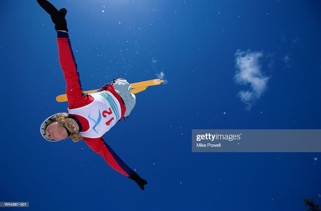 Skier upside down in air, low angle view