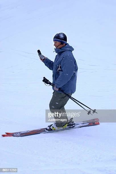 Skier using cell phone