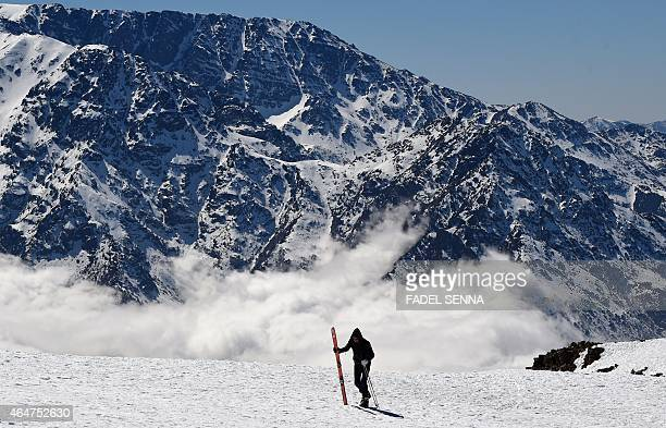 A skier walks on a slope at the Oukaimeden ski resort in the Atlas Mountains 30 kilometres from the popular tourist resort of Marrakesh on February...
