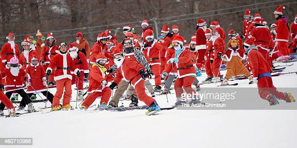 Skiers and snow boarders wearing Santa Claus costumes enjoy at Mt Jeans Nasu on December 20 2014 in Nasu Tochigi Japan The ski resort offers those...
