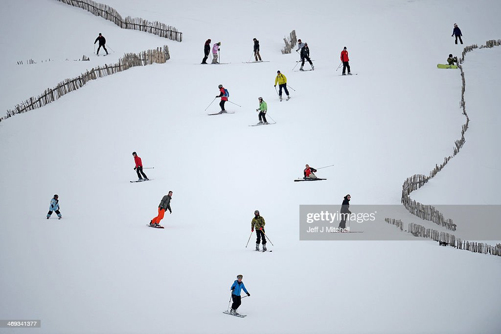 Skiers and snowboarders enjoy the recent snowfall at Glenshee ski center on February 14, 2014 in Glenshee, Scotland. Snow, rain and wind are affecting parts of the UK with seventeen severe flood warnings still in place for parts of Somerset, Berkshire, Surrey and Gloucestershire.