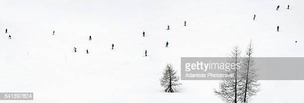 Skiers at ski area near Colfosco in the Dolomites