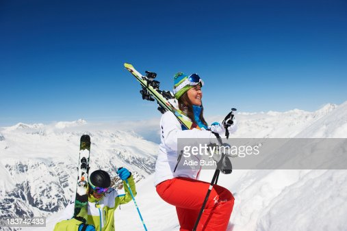 Skiers climbing