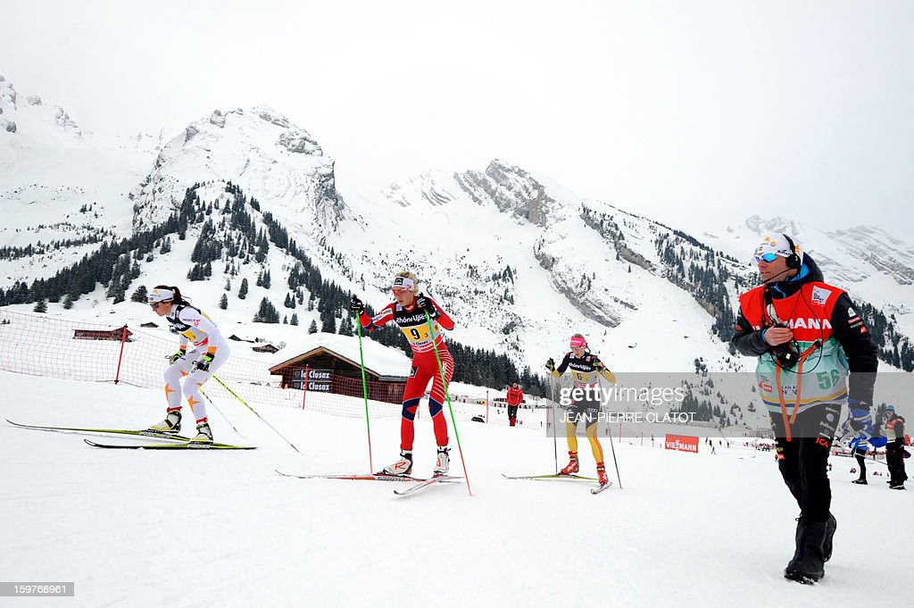 Skiers compete in the Ladies's Nordic skiing combined World Cup relay (4 x 5 km) on January 20, 2013 in La Clusaz, eastern France. AFP PHOTO JEAN-PIERRE CLATOT