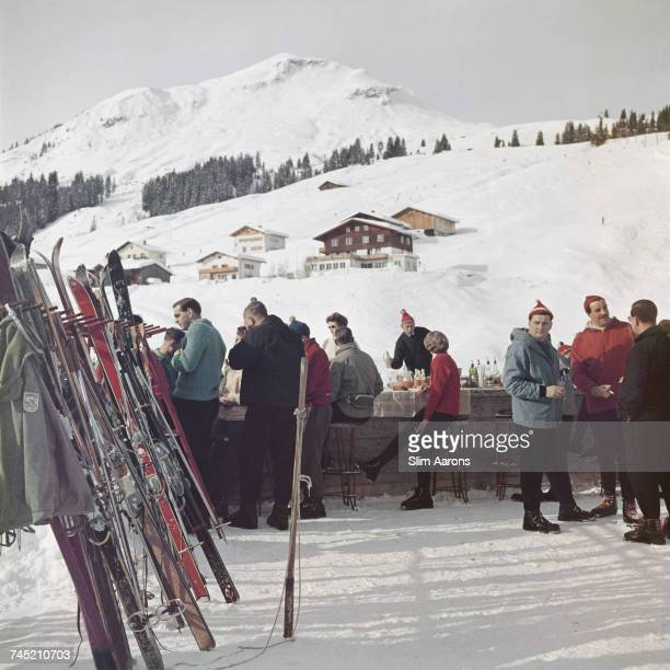 Skiers enjoy a drink by the Ice Bar at the Hotel Krone in Lech Austria 1960