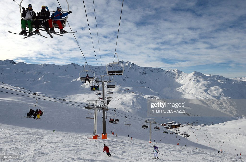 Skiers enjoy the ski runs on December 19, 2012, the French Alps resort of Val Thorens. Due to heavy snowfall, many resorts started opening on December 8 and 15, creating two more weeks of business for resorts before Christmas. Many operators are reporting strong bookings for the Christmas and New Year holidays. AFP PHOTO / PHILIPPE DESMAZES