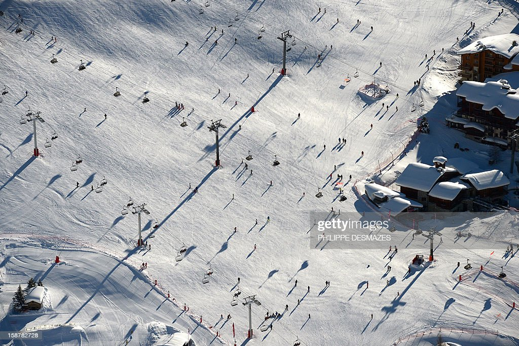 Skiers enjoy the ski runs on December 28, 2012, in the French Alps resort of Val d'Isère. France's ski slopes are set to be busier than last year as early snow falls encourage higher bookings than last year, according to an industry spokesmen and a study released on December 18, 2012.