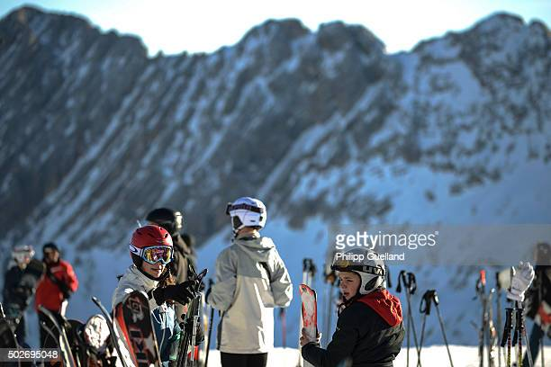 Skiers gesture on a sunny day with temperatures of up to nine degrees Celsius at Zugspitze ski resort in the German Alps on December 28 2015 near...