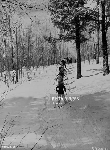 Skiers 'herringbone' their way up a hill on the Anvil Ski Trail Nicolet National Forest Wisconsin USA
