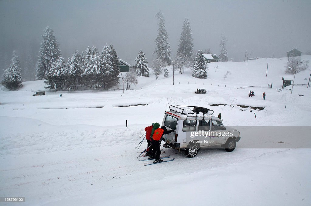 Skiers hold onto a moving vehicle after a snowfall on December 29, 2012 in Gulmarg, 54 km (35 miles) to the west of Srinagar, the summer capital of Indian-administered Kashmir, India. With the second round of heavy snowfall in Kashmir valley, skiers from around the globe have descended on the ski resort of Gulmarg, known for long-run skiing, snow-boarding, heli-skiing and steep mountains. Gulmarg is located less than six miles from the ceasefire line or Line of Control (LoC) that divides Kashmir between India and Pakistan. As a sense of normalcy has started to return to this strife-torn region, various foreign governments, including the United Kingdom, have lifted the travel advisory to its citizens traveling to Kashmir, raising the hopes of the local tourism industry, officials said.