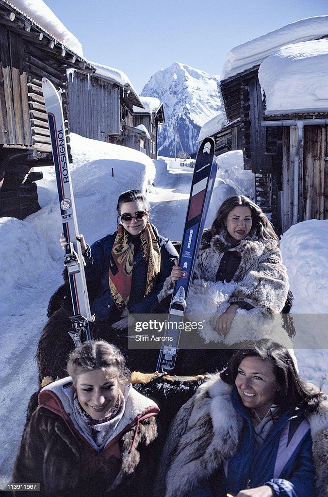 Skiers in a horsedrawn gondola in Klosters Switzerland March 1981
