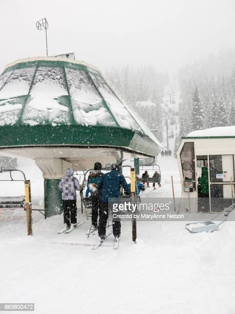 Skiers Loading on a Chair Lift on a Snowy Day