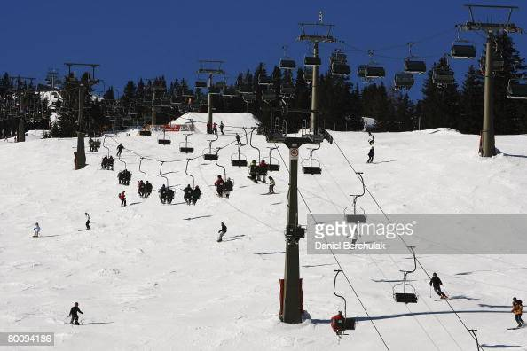 Skiers make their way across the Austrian ski holiday resort of Lech am Alberg on February 10 2008 in Lech Austria