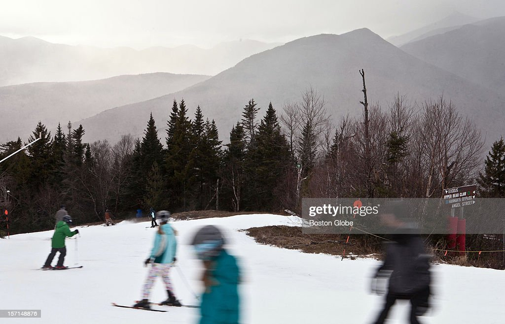 Skiers make their way down Exodus run at Loon Mountain Resort in Lincoln, New Hampshire on November 24, 2012.