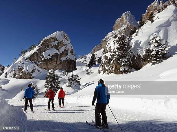 Skiers make their way thrugh Plan de Gralba on the Sella Ronda tour in the Dolomite SuperSki region on February 6 2014 near Santa Christina Italy The...