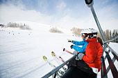 Skiers on a ski lift